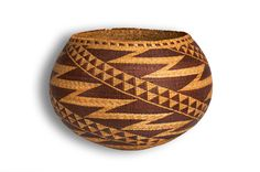 Article cites Mary Benson (c. 1872-1930), a Pomo basketweaver from Mendocino County, CA as the maker. Very pretty!