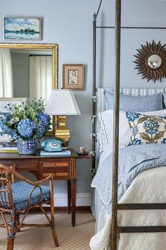 A desk and chair beside a four-poster bed is decorated with a large arrangement of hydrangeas, a vintage-inspired blue phone with rotary dial, a brass lamp, and large rectangular mirror with a brass f Room Interior, Interior Design Living Room, Design Bedroom, Blue Rooms, Blue White Bedrooms, Blue And White Living Room, White Home Decor, White Houses, Southern Living