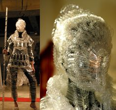 Polyethylene Bottle Myrmidon    This battlesuit, by Kosuke Tsumura, the designer for the Final Home, a brand of urban survival clothing and accessories, was made at the behest of a large cola company. Made entirely of plastic bottles and nylon thread, it is obviously the armor of the future.