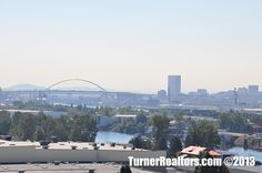 A view of the Willamette River from the St. Johns neighborhood in Portland, Oregon. Portland Neighborhoods, Columbia River, The St, Sydney Harbour Bridge, Portland Oregon, Small Towns, The Neighbourhood, University, Park