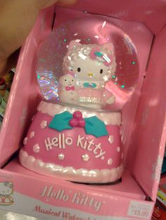 Hello Kitty snow globe.  Use w/ flowers and balloons as part of Hello Kitty table decoration for Bday party in December.