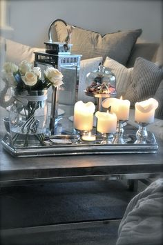 Foyer table styling - silver lantern, vase with greenery, a pedestal container needed with a dome.