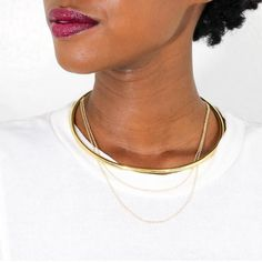 Description Details    The Delicate Chain Choker features a hand-cast open collar combined with a double-strand necklace allowing for a flawless layered look.      Recycled brass is cast, polished and handcrafted by Kenyan artisans using heritage techniques. Made of cast brass Handcrafted in Kenya Your purchase promotes artisan innovation + entrepreneurship Product Care Guide
