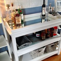 This is a new bar area in our dining room. Shhhh...it was originally my changing table. It's been painted and I had mirrors cut. Works great. It's a repurposed Pottery Barn item. Cheers!