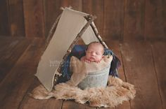 puyallup tacoma organic newborn photographer camping tent Pacific Northwest baby bodhi earthtones earthy inspiration wool plaid sheepskin barnwood
