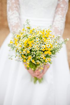 I am putting chamomile flowers in my future bouquet for sure! It may be my favorite flower. If you are allergic to ragweed stay away from chamomile or you will be sneezing through the wedding! Yellow white daisy wildflower bouquet