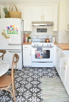 Summer Home Tour Kitchen Updates with retro appliances and painted tile floor