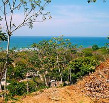5000 m2 lot in Santa Teresa, Costa Rica with 3 building sites all with ocean views, walking distance to the beach and town's center. The best deal available at $ 180,000!