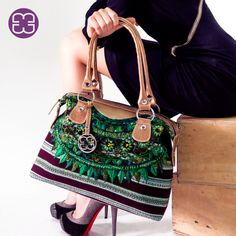 The amazing use of color of the textiles of Patzún, Chimaltenango; is present in this Fancy bag!