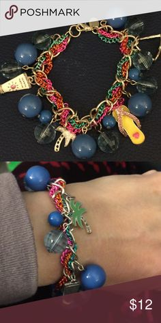 Bracelet with several summer themed charms Colorful bracelet with summer themed charms such as sun glasses, flip flops, sun tan lotion bottle and palm trees 🌴. Never worn Claire's Jewelry Bracelets