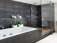 Delightful Remodel Bathroom Design Ideas Featuring Black Full Tile Wall Around Shower Rooom And White Rectangle Bathtubs Added Beauty Flower To Beautify With Bathroom Tile Design Ideas Uk  And Small Bathroom Design Ideas , Charmingly Attractive Bathroom Tile Design Ideas With Modern Style Decor: Bathroom, Furniture, Interior