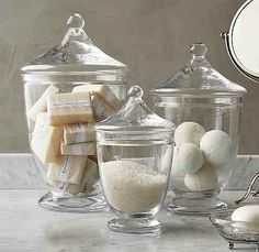 Tabletop decor with glass apothecary jars filled with fresh white and light things