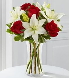 the patter of this flower arrangement is red roses and a white lilys . and greenery throughout the arrangement which makes the red and white pop out more and make a visual pattern Red Wedding Flowers, Red Flowers, Red Roses, Beautiful Flowers, White Roses, Red And White Flowers, White Lilies, Yellow Roses, Pink Wedding Centerpieces