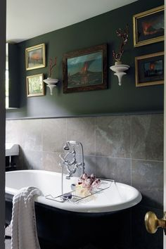 Discover bathroom design ideas on HOUSE - design, food and travel by House & Garden. Charcoal walls provide a dramatic backdrop for volcanic paintings.