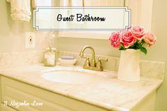 A small guest bathroom with pretty, neutral decor.