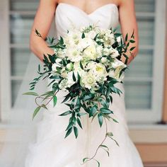 Don't be afraid to add greenery to your bouquet! We love how the greenery fills out this loose bouquet of peonies and garden roses.
