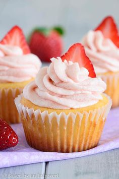 Vanilla Yogurt Cupcakes with Strawberry Frosting- These vanilla yogurt cupcakes are made with a whole cup of yogurt and topped with strawberry frosting.