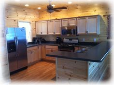 The Kitchen features a suite of stainless steel Whirlpool appliances, plenty of elbow room for the cooks, and a 9-foot peninsula breakfast bar perfect for the kids. Not pictured is the wall-hinged accessible food prep table so that a wheelchair user has knee room.