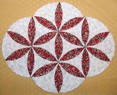 Google Image Result for http://www.designsinstitches.com/Design_Stitchouts/Cathedral%2520Window%2520Quilt%2520Block%2520-%2520Projects/CWQB_2-Placemat_1.jpg