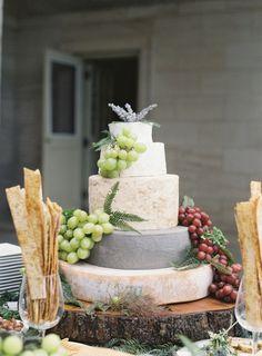 A 'cheese wheel' cake: http://www.stylemepretty.com/2015/08/26/elegant-whimsical-crane-estate-wedding/   Photography: O'Malley Photographers - http://omalleyphotographers.com/