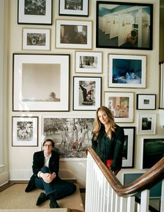 Al and Kimm with their photography collection. On Al, his own J. Crew jacket and jeans. On Kimm, her own Monique Lhuillier blouse; Proenza Schouler pants; and her own black and white enamel bracelets. - TownandCountryMag.com