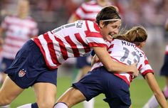 Abby Wambach congratulates Alex Morgan for scoring against Ireland less than a minute into the match on Dec. 1, 2012, in Glendale, Ariz. (Paul Connors/AP)