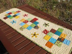 Win a Charm Pack and Fabrics to Make this Darling Table Runner! - Quilt With Us