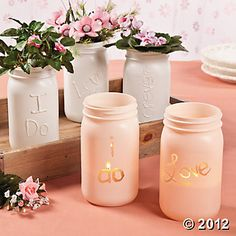 Create these eye-catching personalized glass jar decorations for your wedding tables and use them to add the soft glow of candlelight to your reception, too.