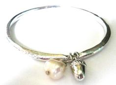 Bangle with acorn and pearl charm £16