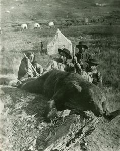 June 25, 1876: Battle of the Little Bighorn and death of Lt. Colonel George Armstrong Custer.  photo: Custer Expedition, 1874: Bloody Knife (guide), General Custer, Private Noonen, and Colonel Ludlow, with grizzly killed by Custer; near Custer Peak (South Dakota); NYHS image #79125d.