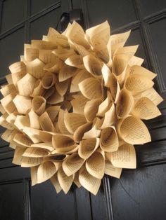 "DIY book page wreath- I've seen this before and I like the way the corner of the page makes the wreath look more ""flower like.)"