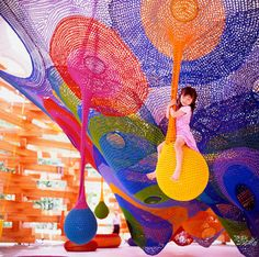 Playscapes are an amazing but often overlooked venue for artists. Toshiko Horiuchi-MacAdam constructs large, interactive crochet nets that provide a totally unique play experience at several sites in Japan. This is an installation at the Hakone Open Air Museum.
