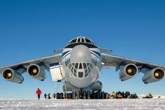 After landing on a runway of hard blue ice, a behemoth Ilyushin IL-76 jet unloads scientists, adventurers, and supplies for the Novolazarevskaya research station. From here, the climbing team flew into the mountains on a smaller plane.