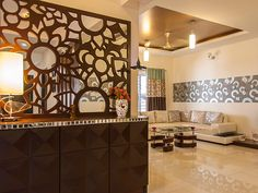 The foyer I designed for this duplex apartment at Vaishnavi Orchids (Sarjapur, Bangalore) has a sophisticated look. The console feautes 3D drawers, laser cut lattice with a mirror backing.
