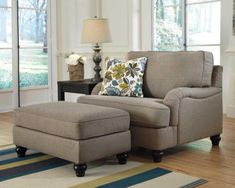 Comfortable Oversized Hariston Chair With Ottoman Ashley Furniture And Unique Pleated Upholstered Look Also Stylish Set Back Arms