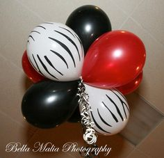 The zebra print, black and red floating balloon arrangements Kelly of Angelic Affairs designed ♥