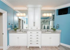 Great cabinetry with lots of storage for everything that normally clutters bathroom countertops...