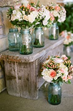 Love the aqua jars: flowers wrapped in burlap or lace then placed in mason jar… simple/rustic idea.This would be good for bridesmaids flowers after the service.