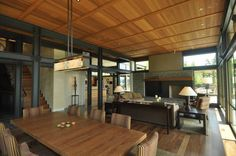 Grand glass lake house with bold steel frame | Modern House Designs