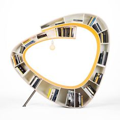 www.littlerugshop.com The #Bookworm 2.0 is both a #chair and a #bookshelf! Curved into a cocoon shaped nook complete with an overhead light bulb this unique piece of #furniture would make an ideal reading spot for any #booklover. Design by Anne Harmsen/Paul Schrijen of #Atelier010 \\ Photo by Caren Huygelen by designmilk