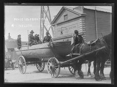 View of a group of men in military uniform seated on the Turkish pontoon which is mounted on a horse drawn cart outside the Fire Brigade Station. WW1