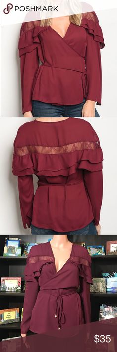 """Wine Colored Wrap Top with Ruffles Long sleeves; ruffle details; Long sleeve acrylic blend wrap top with ruffle and lace details, along with a v neckline. Fabric Content: 100% RAYON Measurements: Small: L: 28"""" B: 26"""" W: 26"""" Medium: L: 29"""" B: 27"""" W: 27"""" Large: L: 30"""" B: 28"""" W: 28"""" Tops Blouses"""