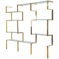 View this item and discover similar shelves for sale at - Architectural brass etagere shelving unit after Milo Baughman, Wall mount system that can be adjusted to various widths to suite your space. Brass Shelving, Metal Shelving Units, Shelving Systems, Modern Shelving, Adjustable Shelving, Suspended Shelves, Jewelry Store Design, Jewelry Shop, System Furniture