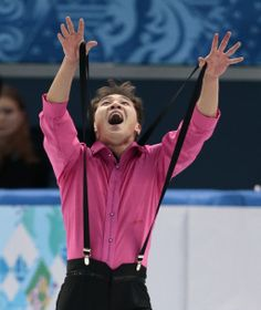 Abzal Rakimgaliev of Kazakhstan competes in the men's short program figure skating competition at the Iceberg Skating Palace during the 2014...