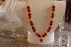 Red Glass Beaded Necklace with GoldPlated Caps by AngeleDesignsLA, $35.00