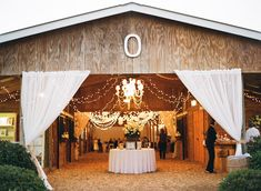 Barn Reception With Sheer Curtains and Chandelier | photography by http://www.lexiafrank.com/