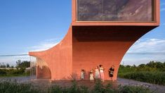Chinese practice Atelier Xi has completed Peach Hut, a tinted concrete community pavilion and bar overlooking a field of peach trees in Henan Province. China Architecture, Minimal Architecture, Contemporary Architecture, Public Architecture, Industrial Architecture, Architecture Design, Cabana, Bangkok, Federal