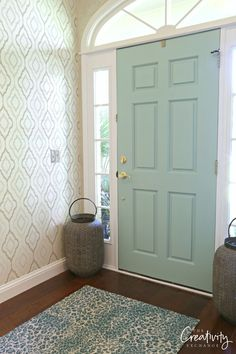 Front door painted with Hazel by Sherwin Williams.
