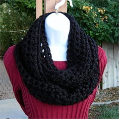 Solid Black INFINITY LOOP COWL SCARF, 62 x 5   Soft, Warm, and Thick Infinity Scarf hand-crocheted with a high quality acrylic/wool blend yarn. Even though the yarn is categorized as Super Bulky, its very lightweight.   The color is a beautiful deep black.   Yarn Content: 80% Acrylic/20% Lambs Wool  Yarn Brand: Lion Brand Wool-Ease Thick  Quick  Yarn Label Color: Black  Approximate Length (full circumference unstretched): 62 inches/157 cm  Approximate Width: 5 inches/12.7 cm  Thickness: 1/2…