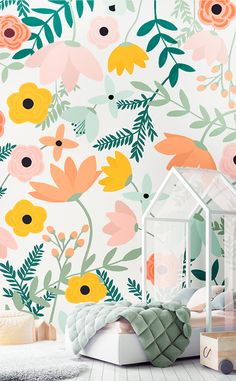 Major bedroom envy! It's hard not to get inspired by this colorful girl's bedroom with popping pastels and stylish color palette. This floral wallpaper design features delicately hand-painted flowers that intertwine to give you an amazing accent wall.
